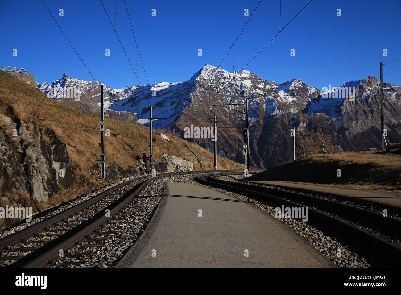 View from Alp Grum, curved track of the Bernina railway - Stock Image