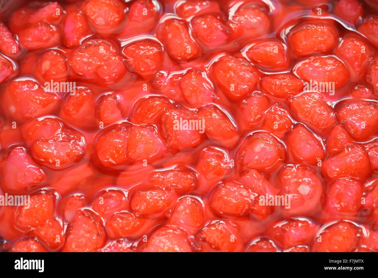 red ruby(tub tim krob) is a traditional dessert in thailand made with water chestnuts in coconut milk. - Stock Image