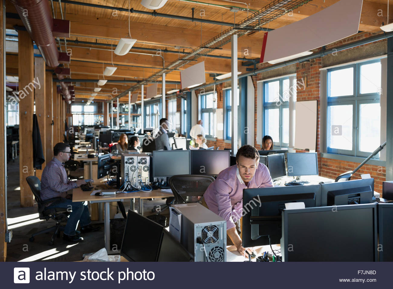 Business people working in open office - Stock Image