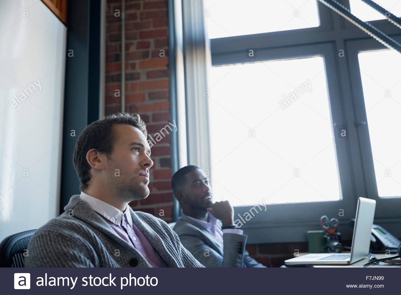 Businessmen in meeting - Stock Image