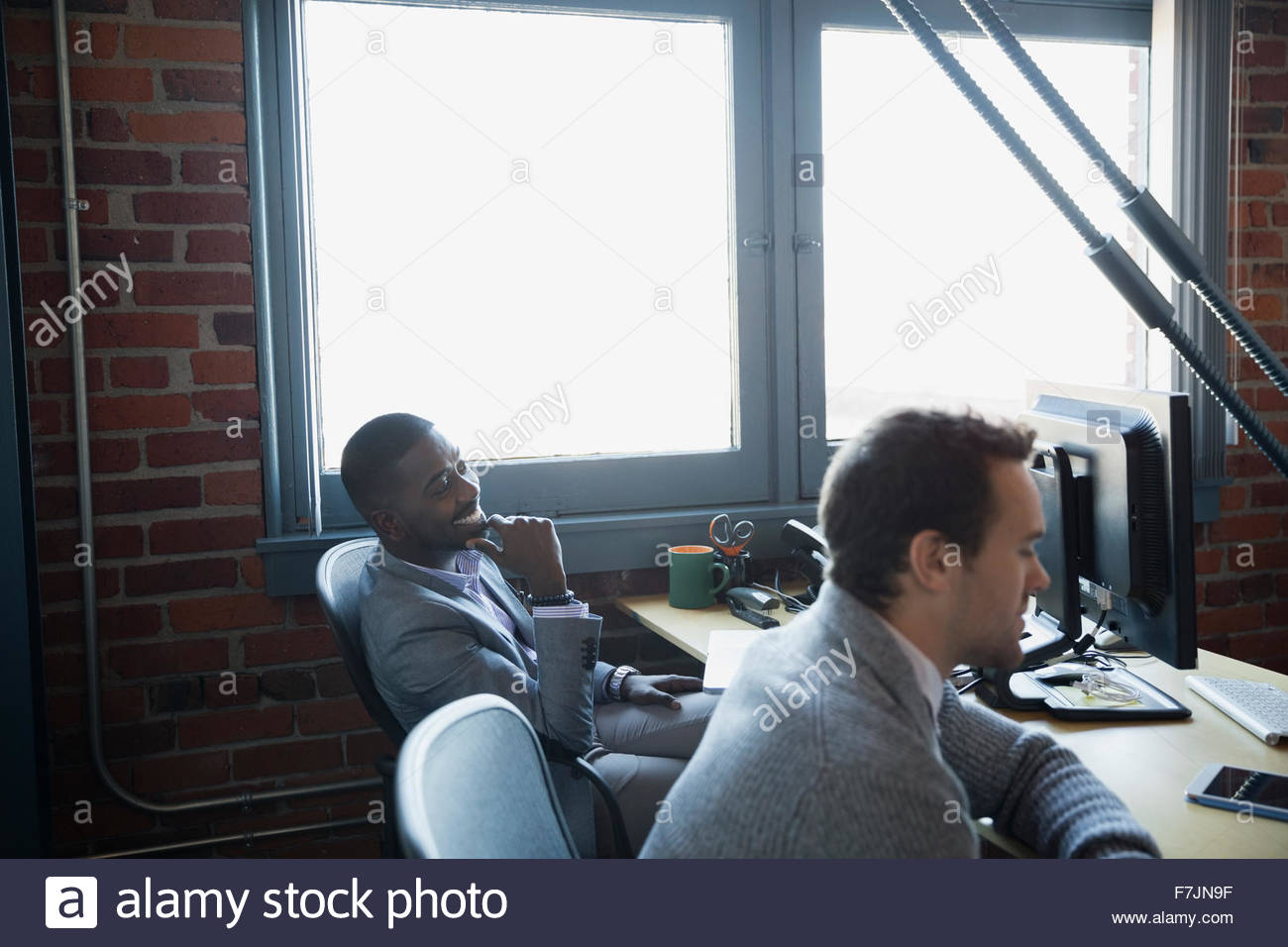 Businessmen in meeting - Stock Image
