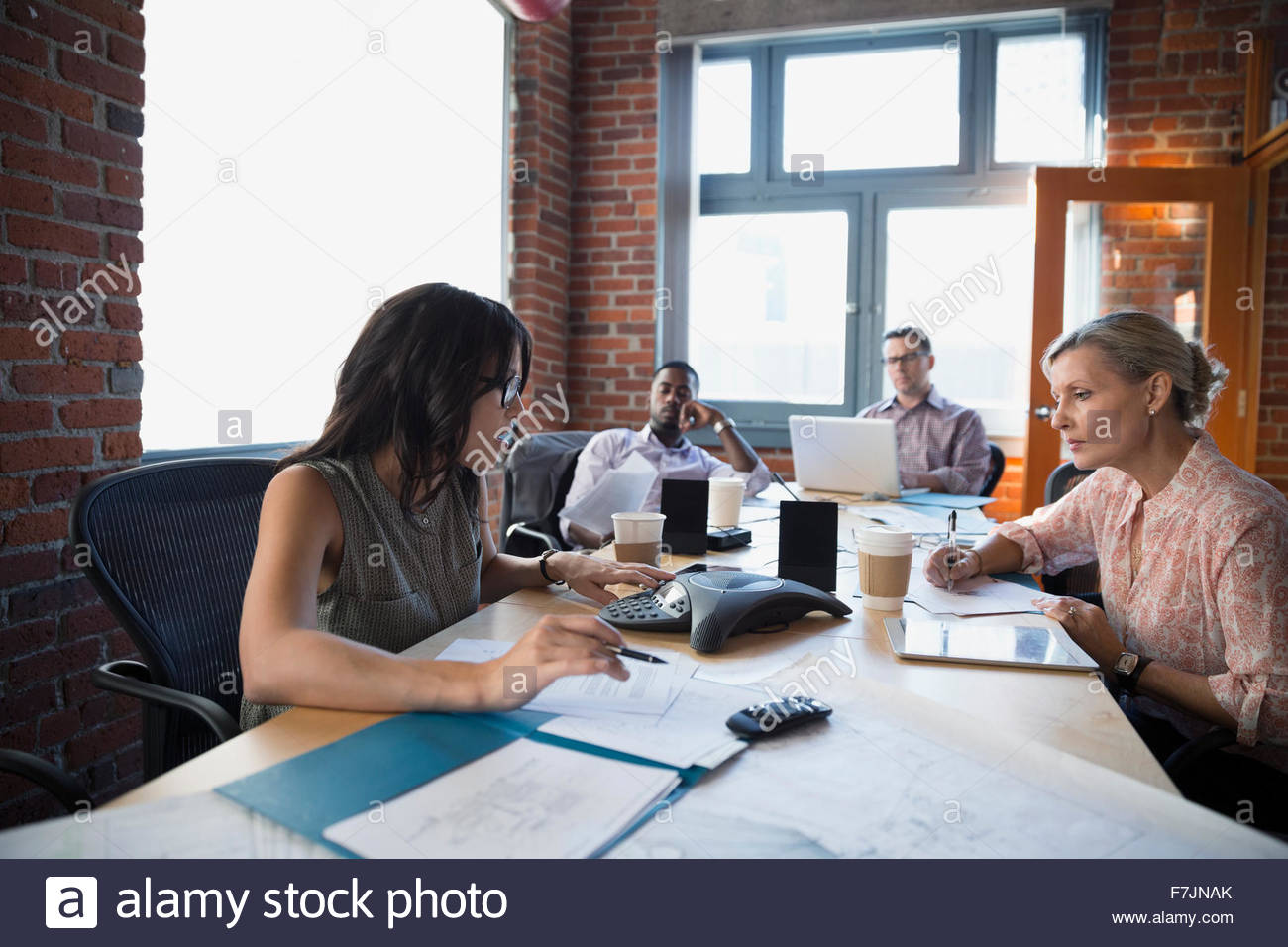 Business people in conference call meeting - Stock Image