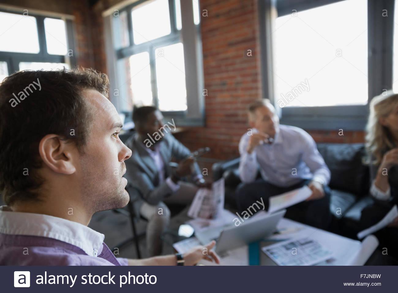 Business people looking away in meeting - Stock Image