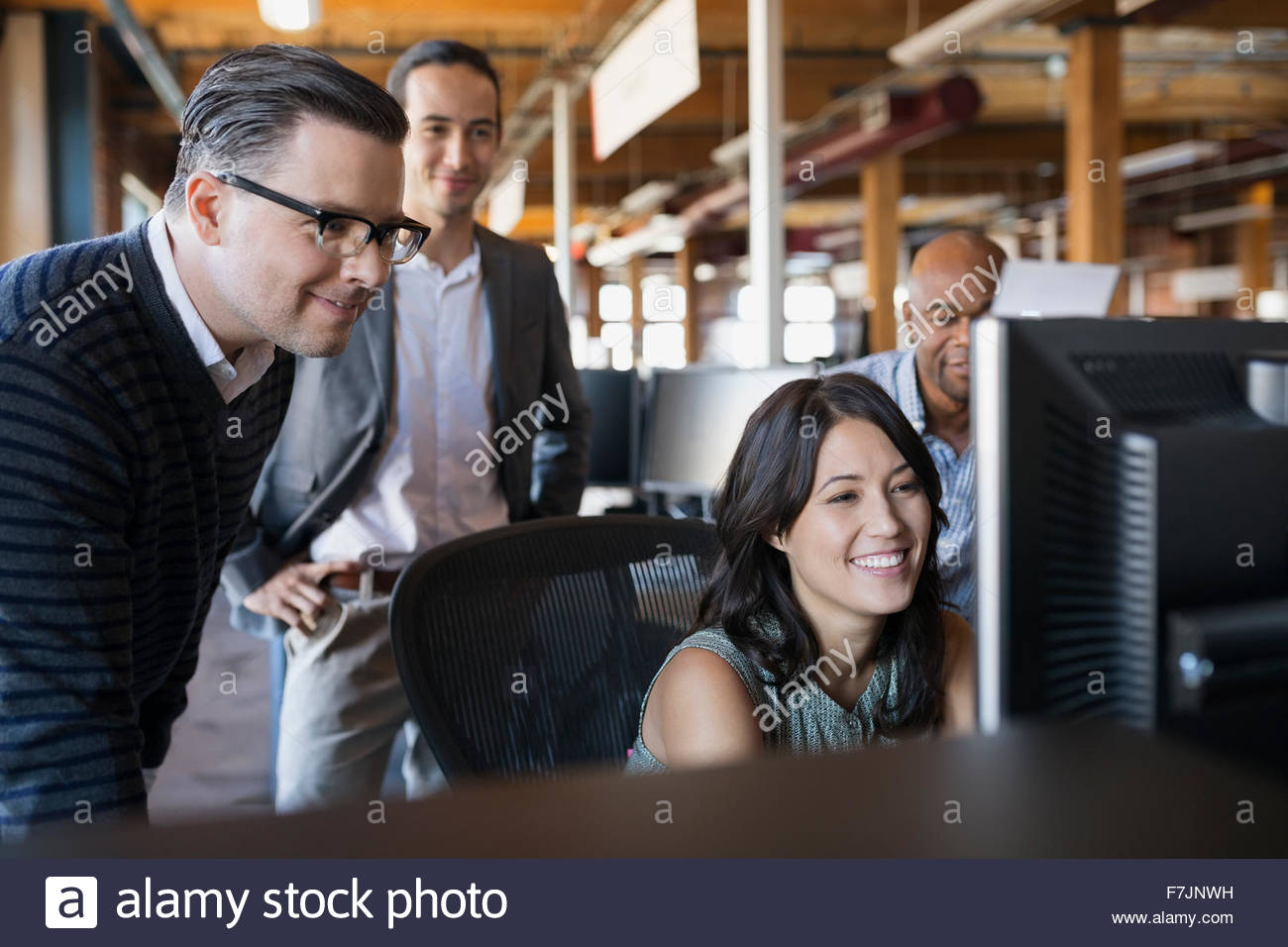 Business people working at computer in office - Stock Image