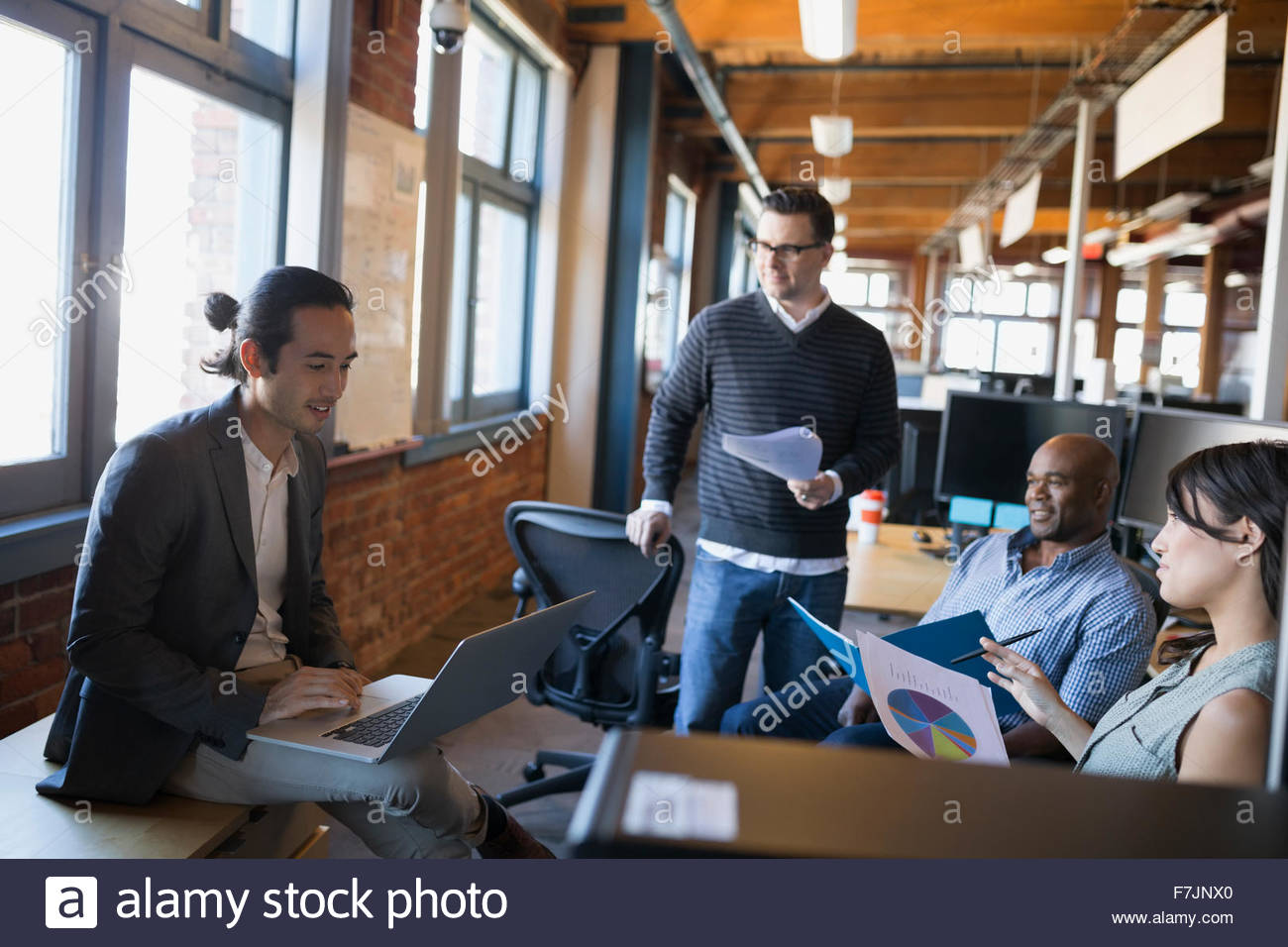 Business people meeting with laptop and paperwork office - Stock Image