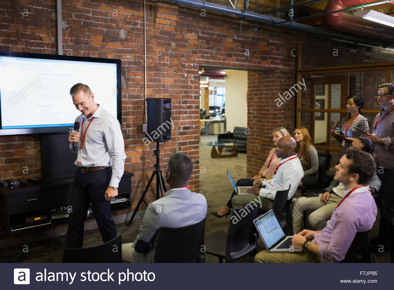 Businessman leading conference presentation - Stock Image