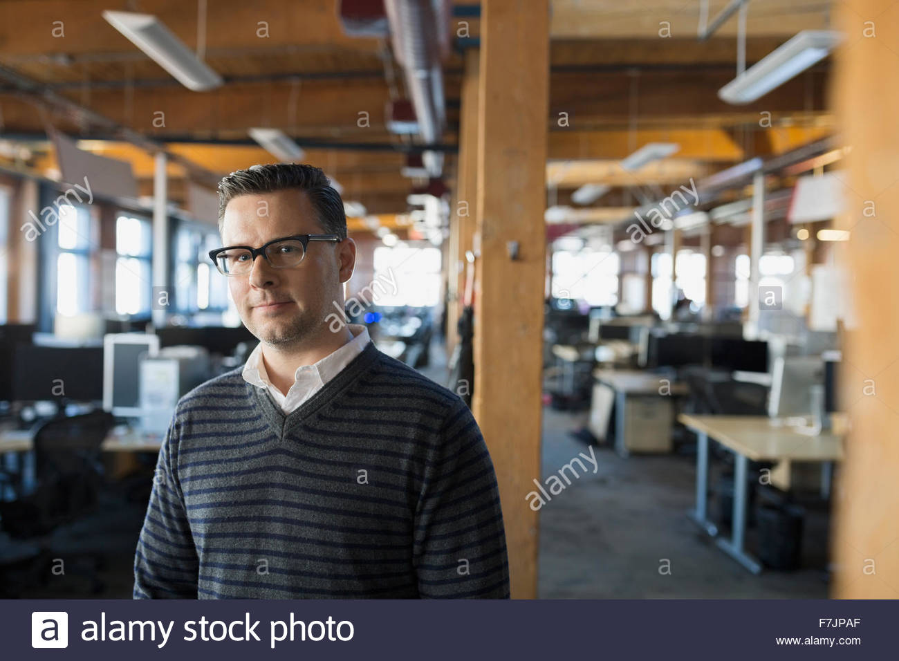 Portrait serious businessman in office - Stock Image