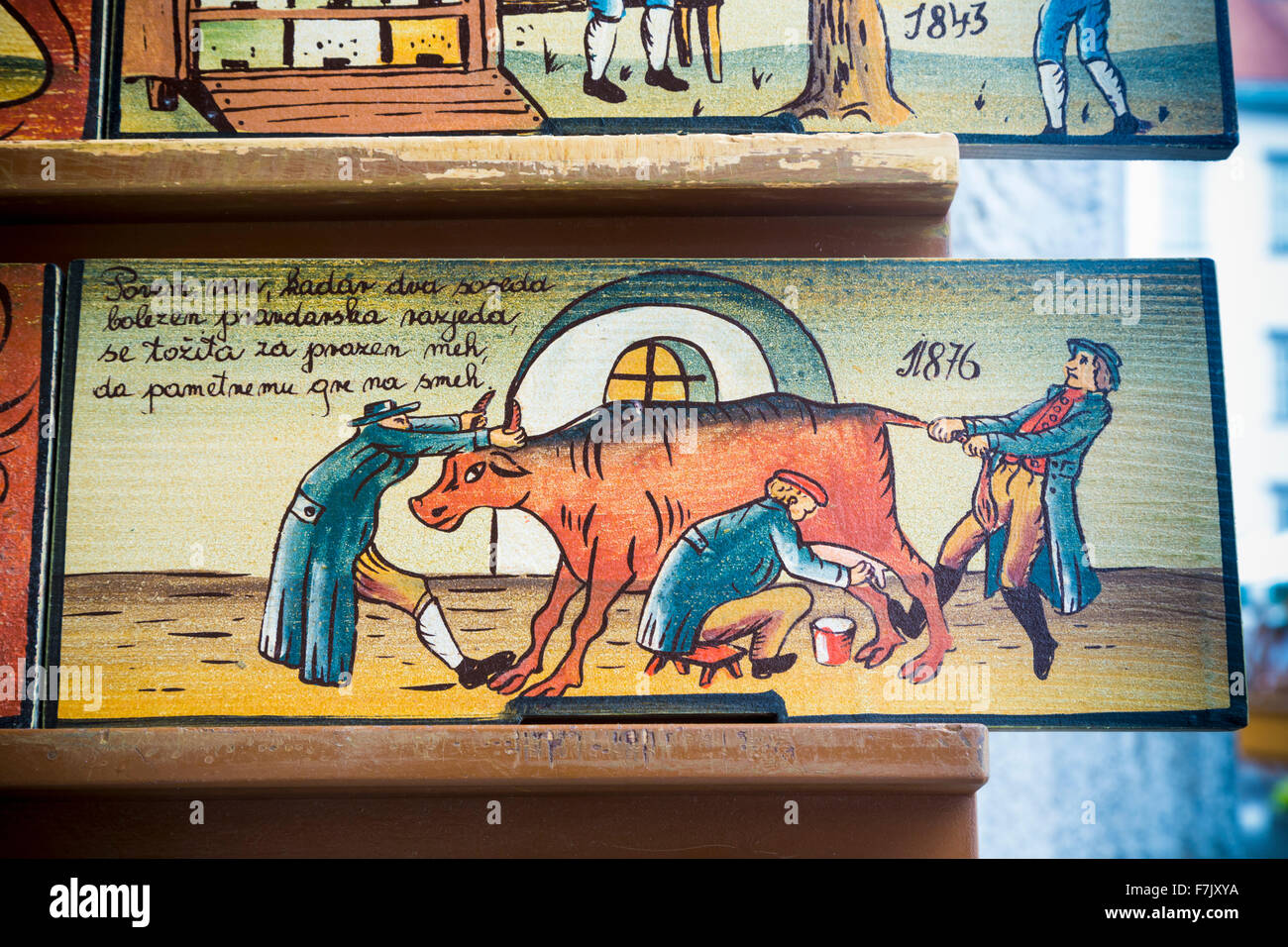 Beehive panels, Slovenia. Copies of originals are a souvenir item with visitors. Originally, the panels decorated - Stock Image