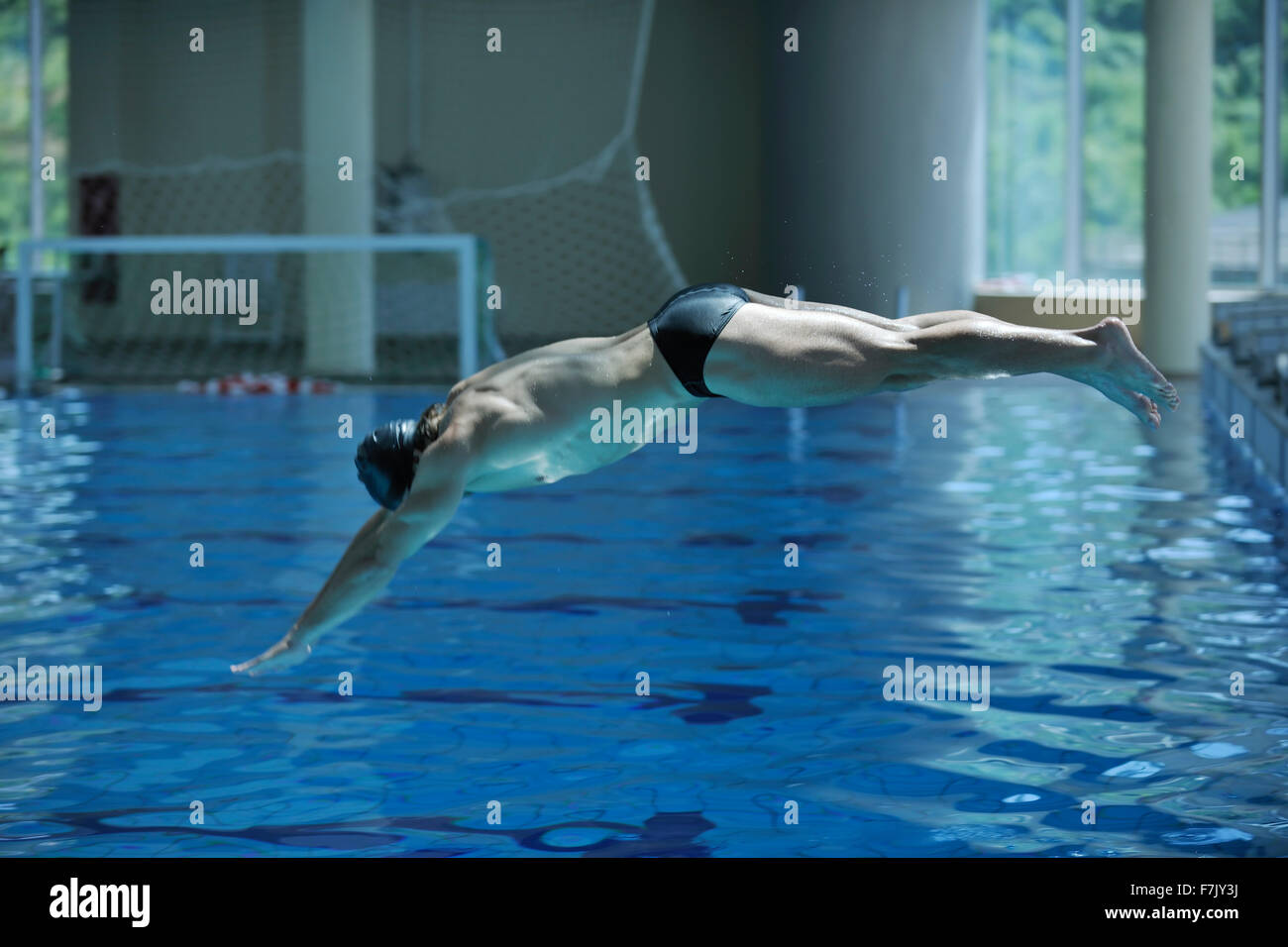 Young Swimmer On Swim Start At Swimming Pool Ready For Jump Race And Win