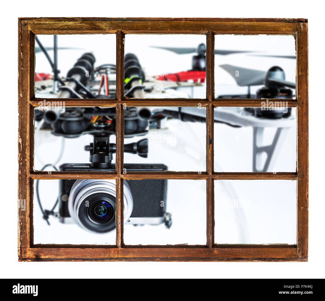 drones and privacy invasion concept - blurred oversized drone flying with a camera outside the window - Stock Image