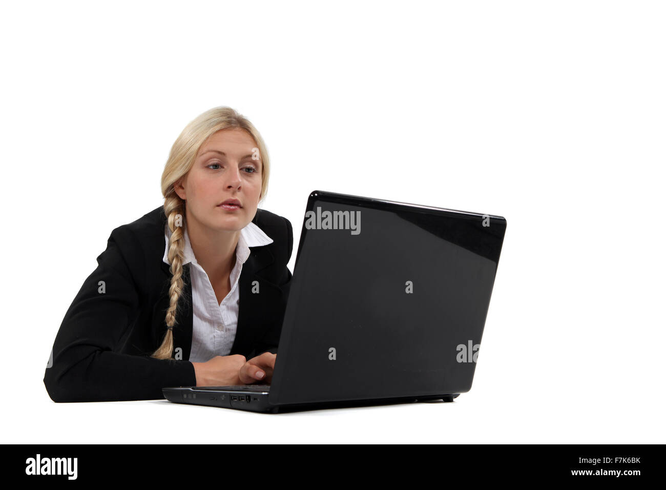 Uninterested blond office worker Stock Photo