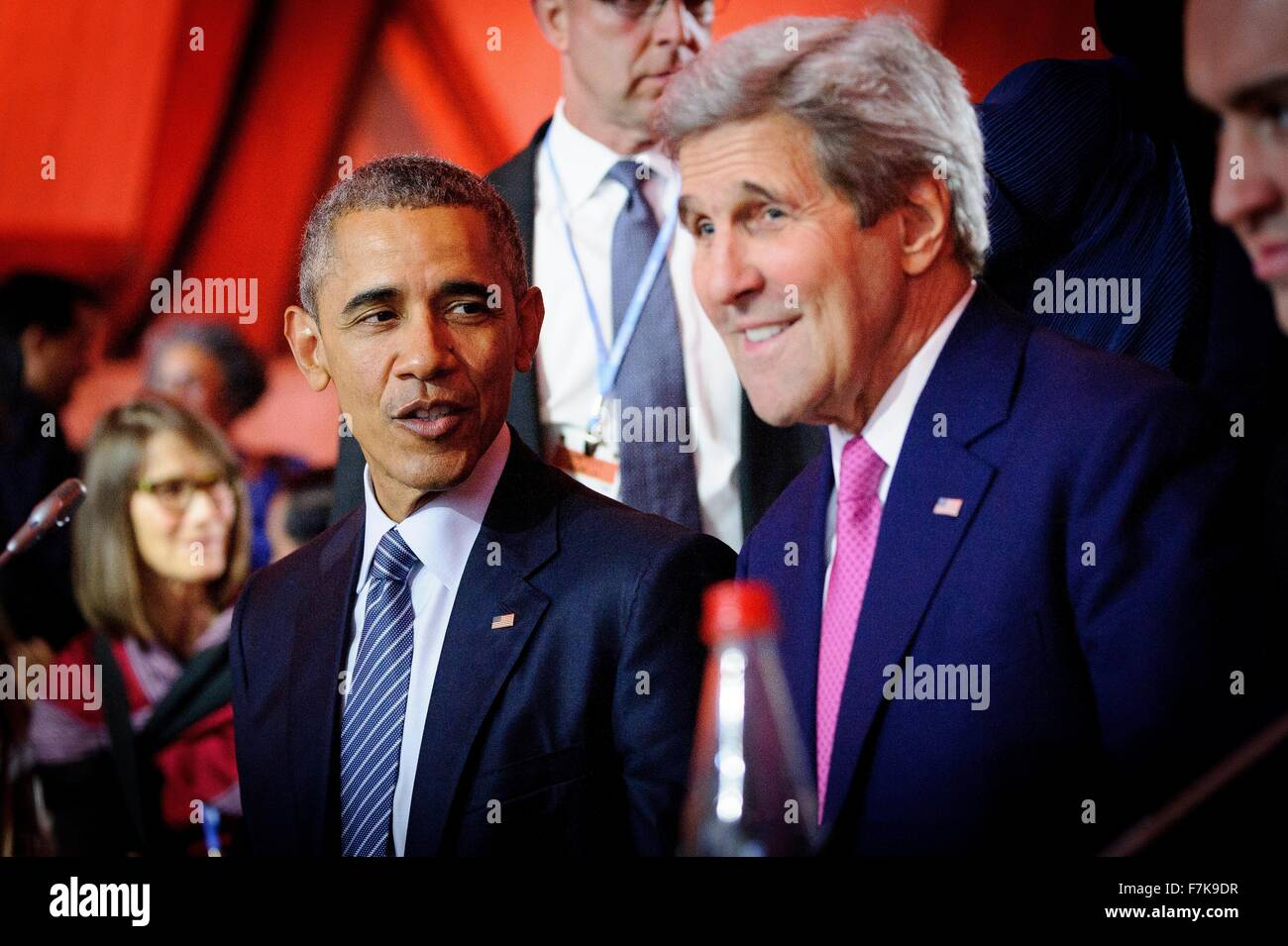 U.S. President Barack Obama talks with Secretary of State John Kerry during the opening plenary session of the COP21, - Stock Image