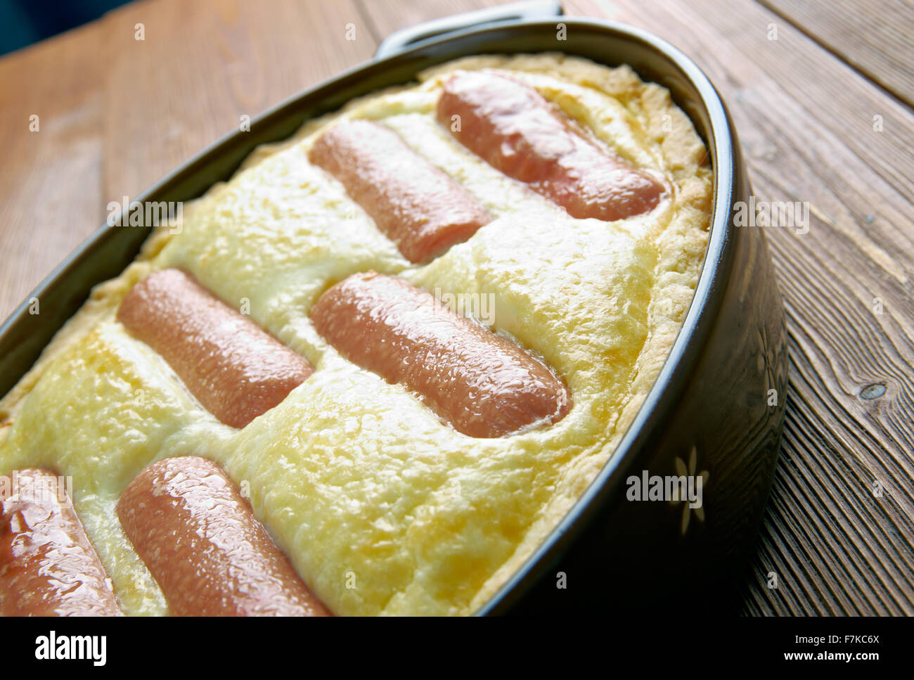 Toad in the hole -  traditional British dish consisting of sausages in Yorkshire pudding batter - Stock Image