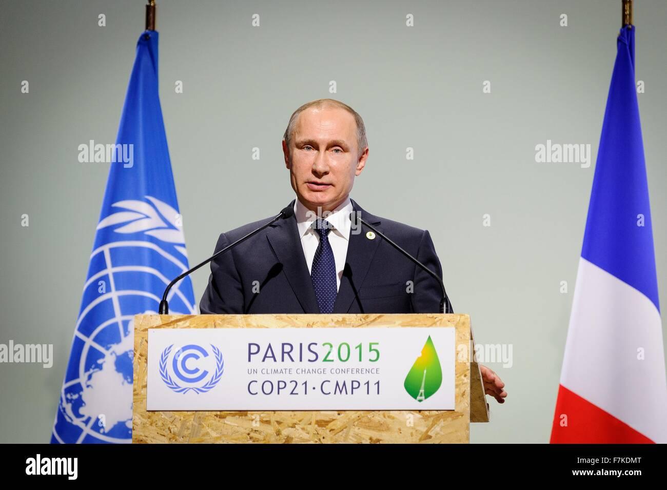 Le Bourget, France. 30th November, 2015. Russian President Vladimir Putin addresses the opening plenary session - Stock Image