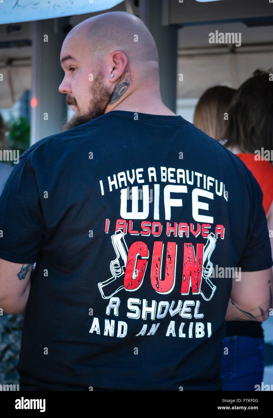Tattooed Man wearing offensive tee shirt threatening anyone