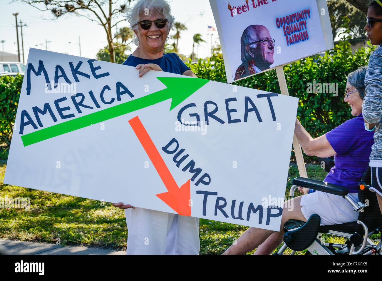 Protesters holding signs denouncing Donald Trump at a political rally for Trump in Sarasota, FL - Stock Image