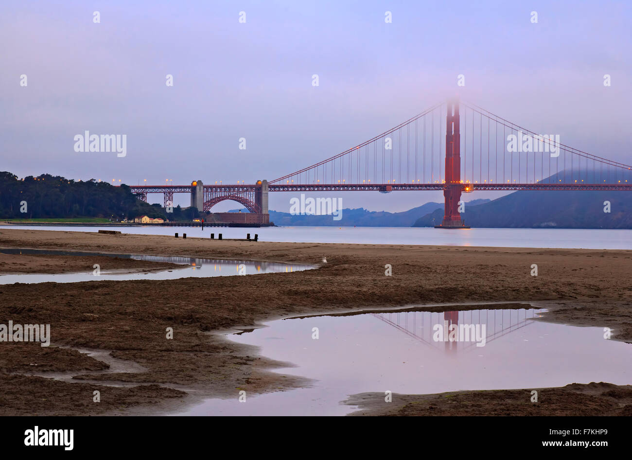 Golden Gate Bridge reflected in pond (in Crissy Field) and fog, San Francisco, California USA - Stock Image