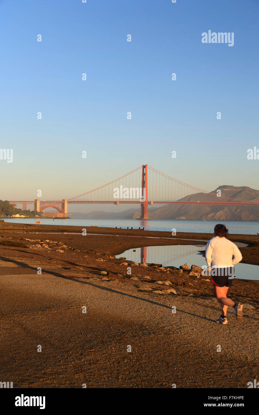 Male runner (on Crissy Field) and Golden Gate Bridge, San Francisco, California USA Stock Photo
