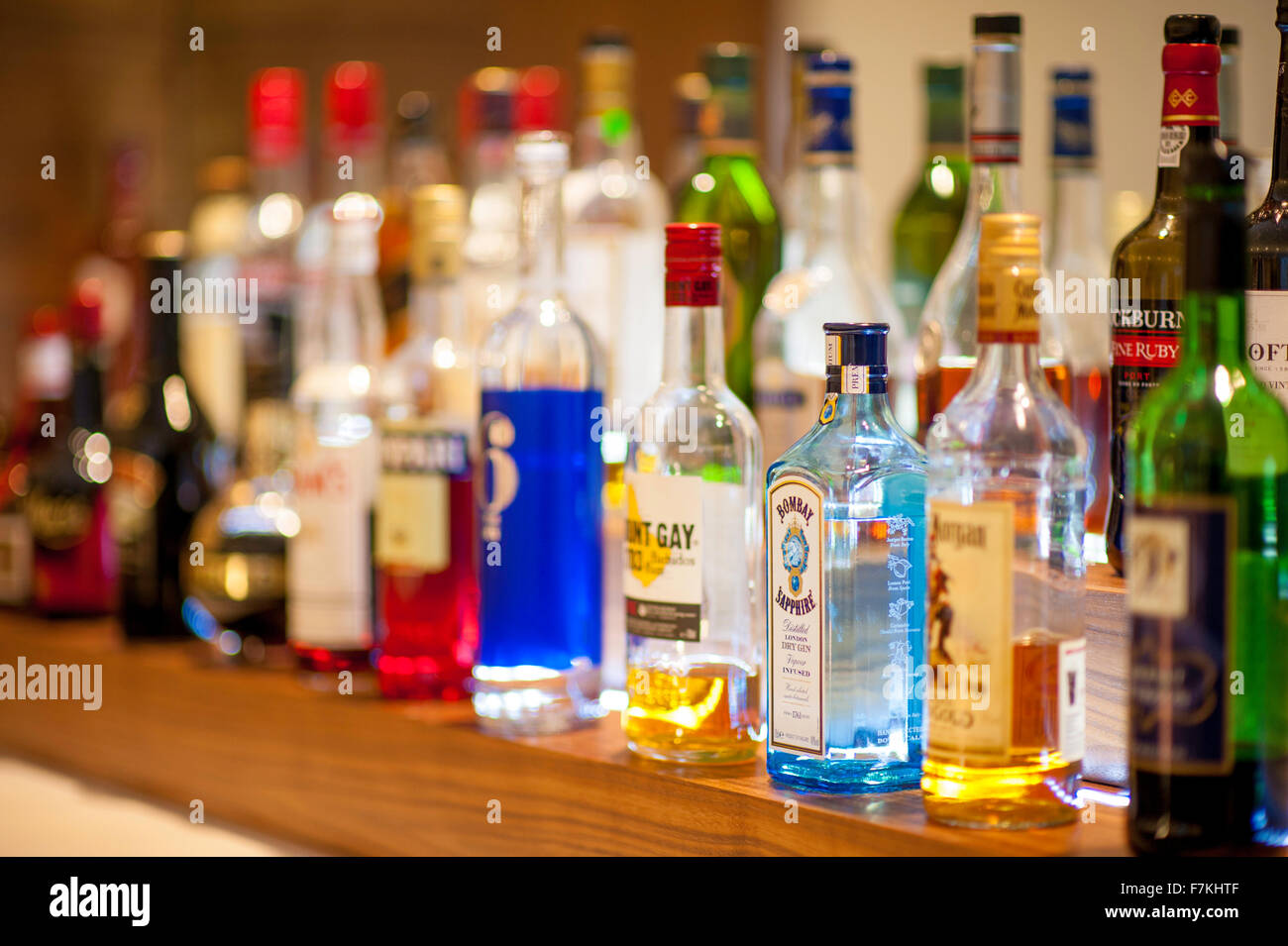 A line of spirits on a bar - Stock Image