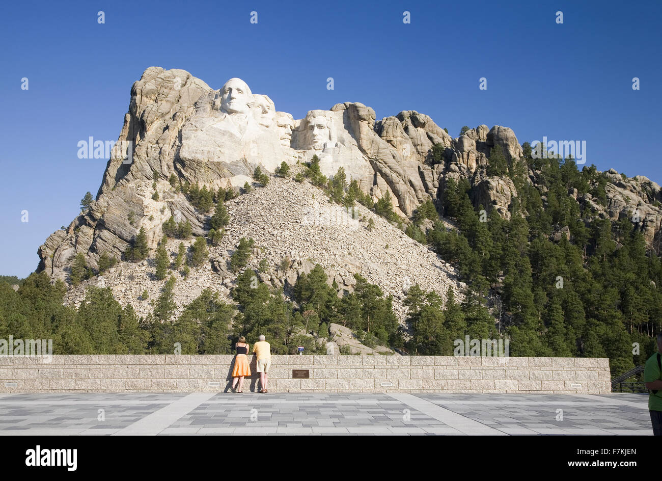 A man and woman at the Grand Terrace view of Mount Rushmore National Memorial, South Dakota Stock Photo