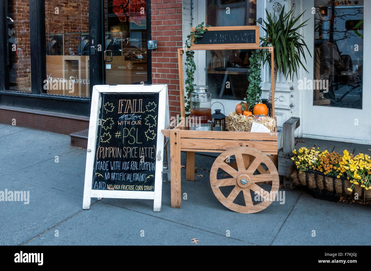 PSL (Pumpkin Spice Latte) for sale outside a bar restaurant in Soho in New York City - Stock Image