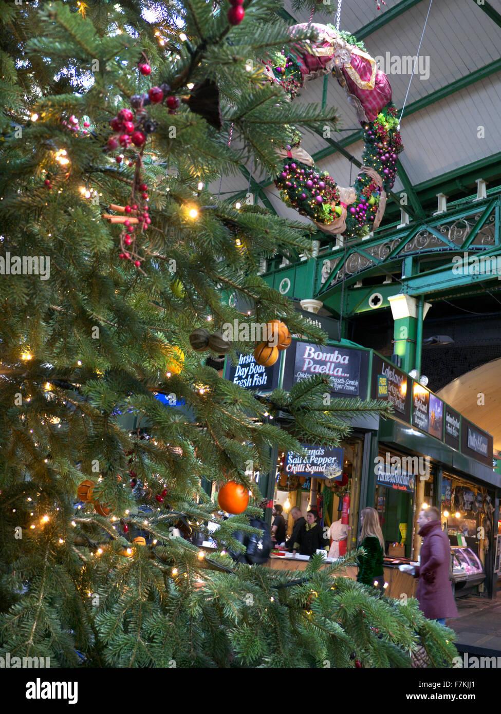 Borough Market stalls viewed through Christmas tree and lights Southwark London Stock Photo