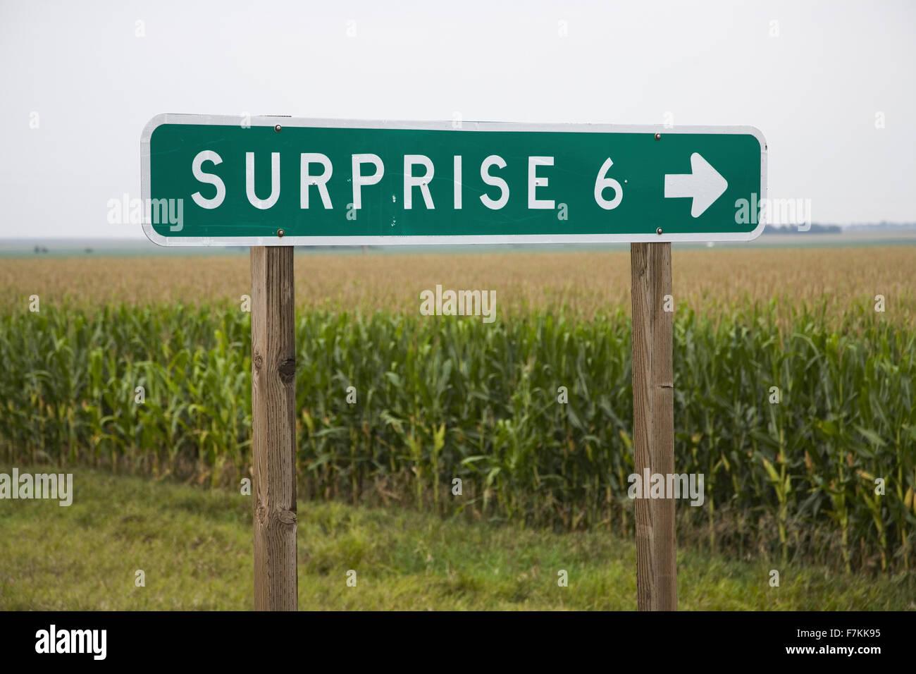 Road sign pointing to Surprise, Nebraska Stock Photo