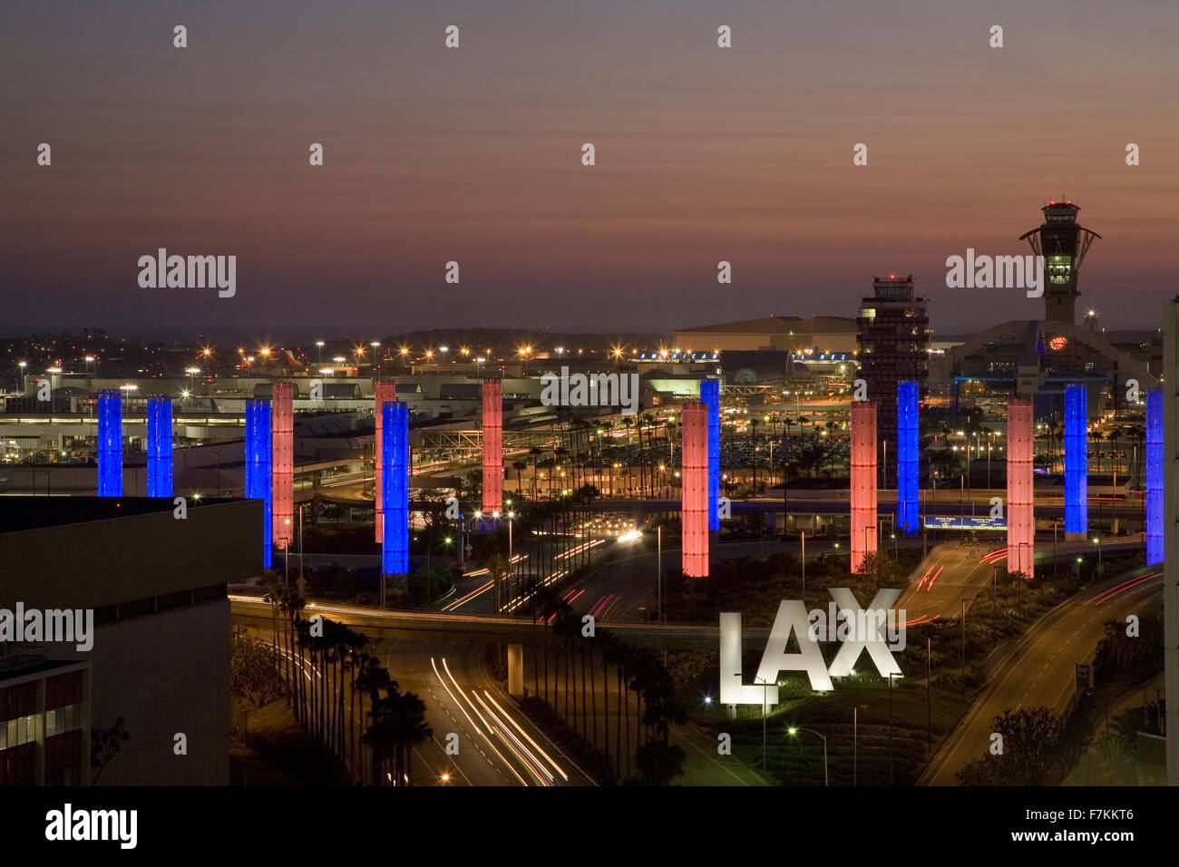 Aerial view of LAX Los Angeles International Airport at sunset with decorative light tubes, Los Angeles, California - Stock Image