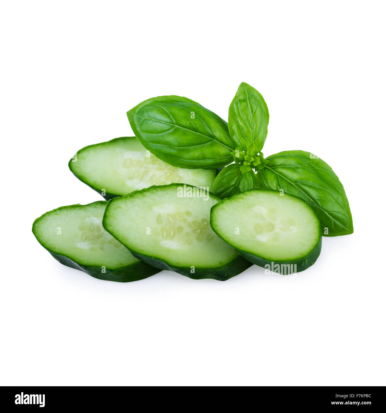 Cucumbers Slices Isolated on White - Stock Image