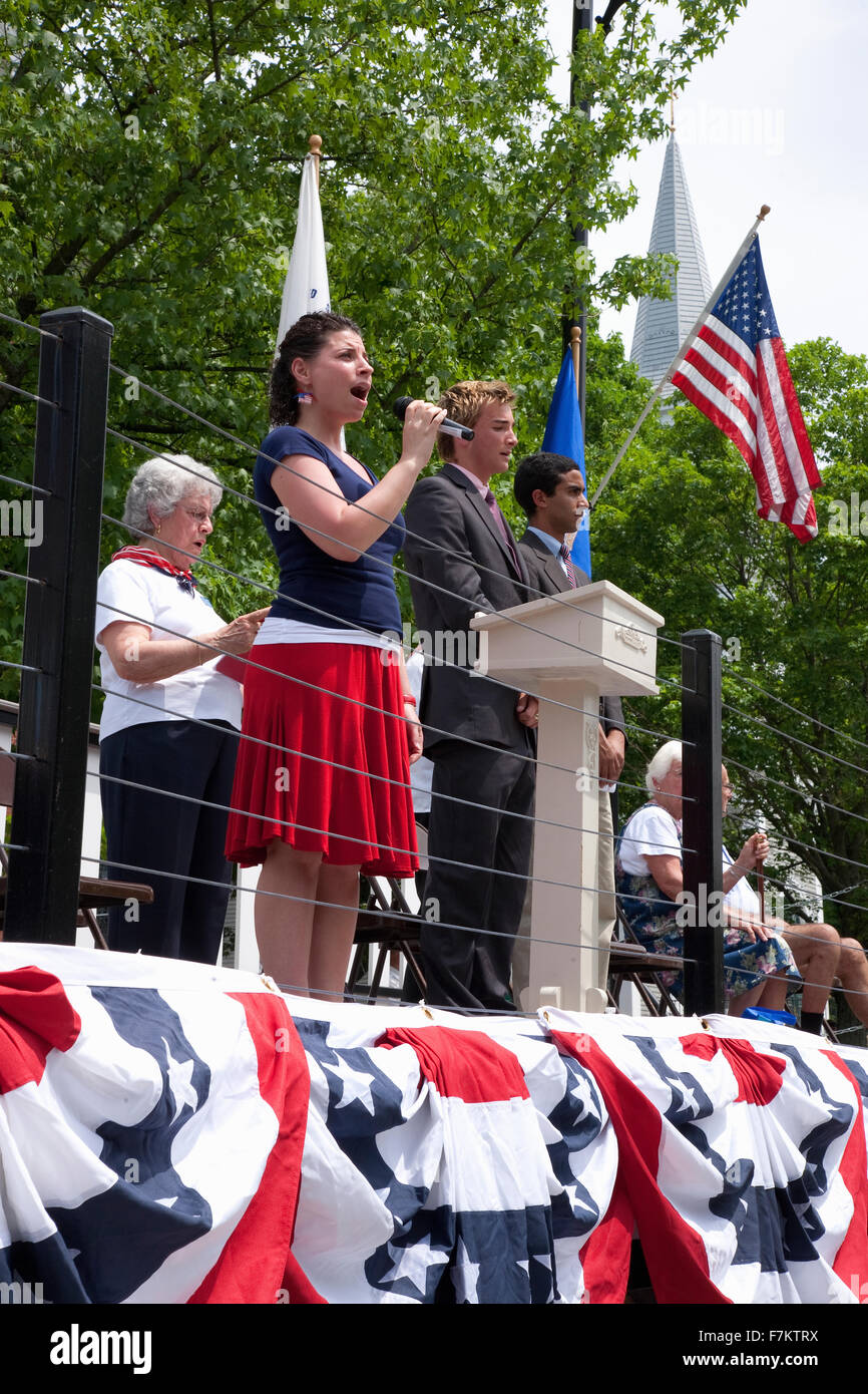 Young woman sings 'God Bless America' during Memorial Day, 2011 Ceremonies, Concord, MA - Stock Image