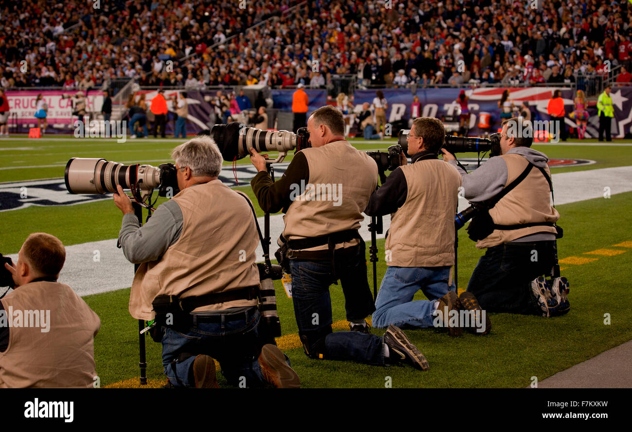 Professional Photographers take images from the sidelines at Gillette Stadium, the home of Super Bowl champs, New - Stock Image