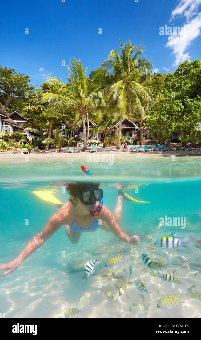 Underwater sea view of snorkeling woman with fish, Ko Samet Island, Thailand, Asia - Stock Image