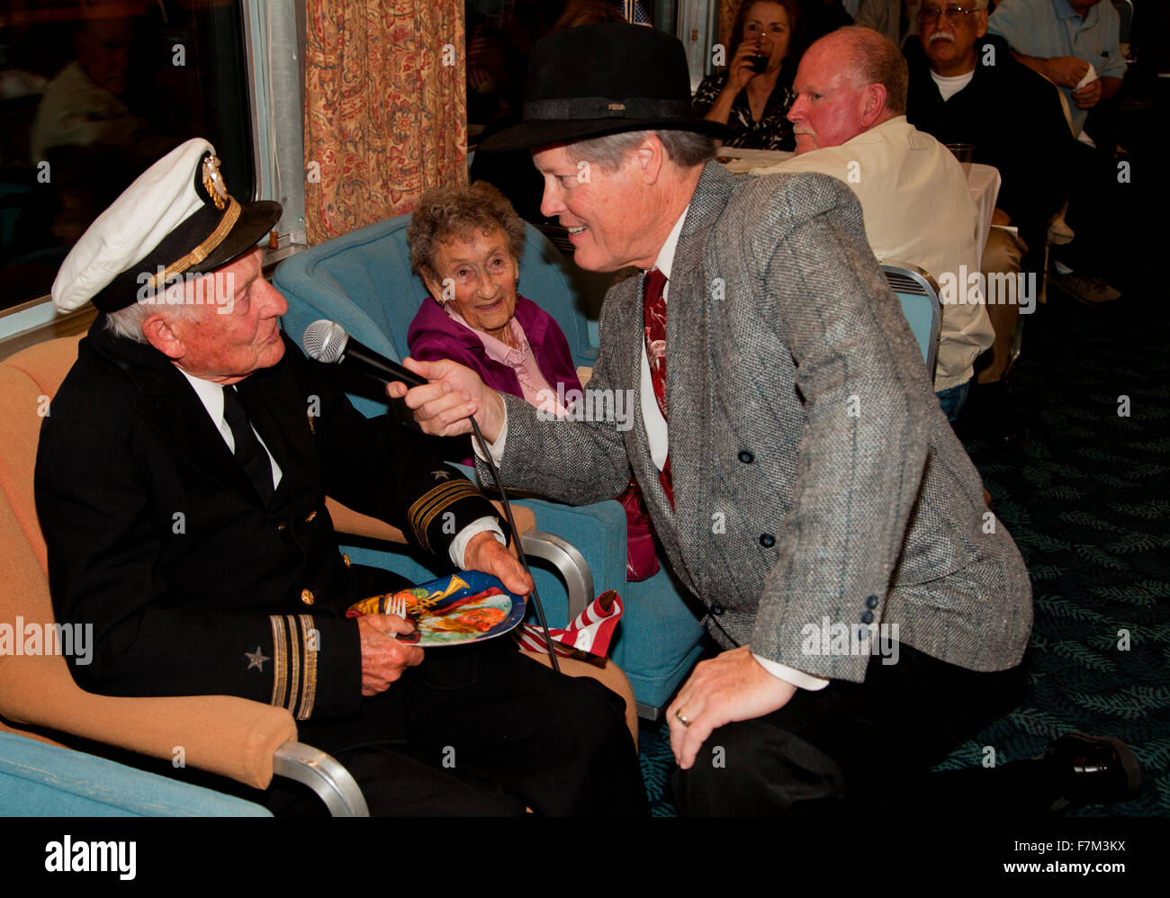 1940's man interviews veteran of Pearl Harbor Day on Pearl Harbor Day Troop train reenactment from Los Angeles - Stock Image