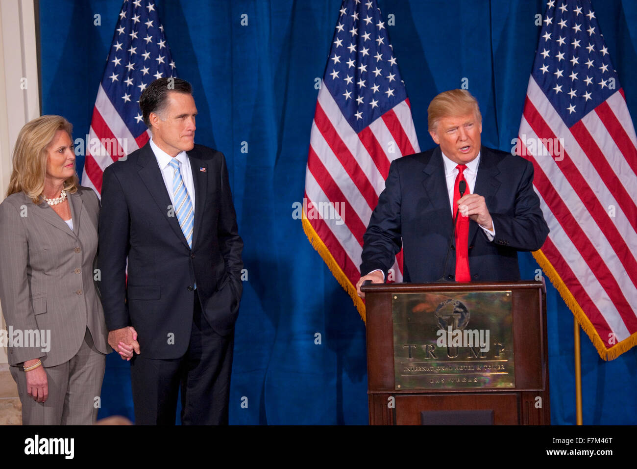 Donald Trump speaks at podium with Republican presidential candidate Mitt Romney after Trump endorsed Romney's presidential - Stock Image