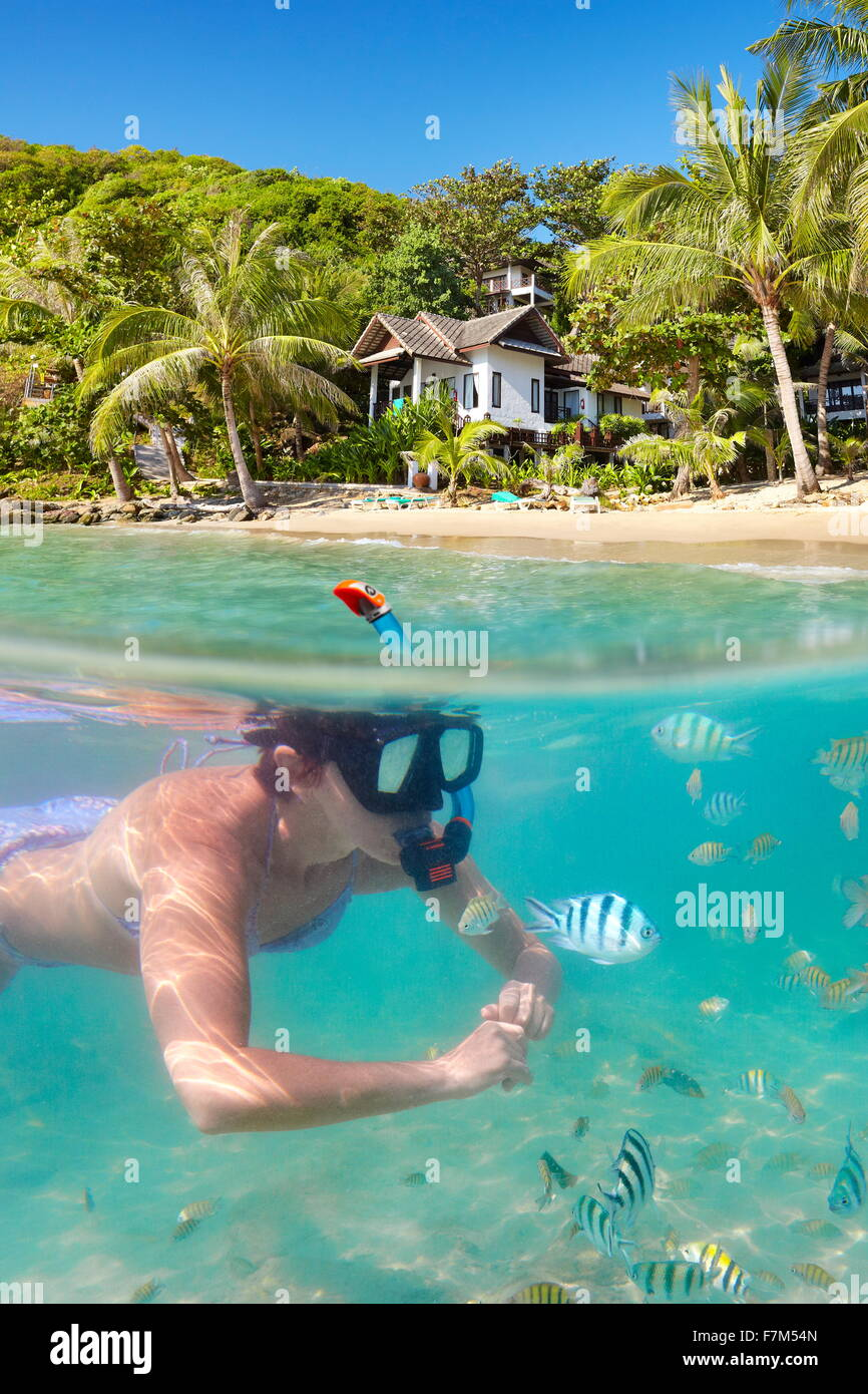 Tropical Ko Samet Island, underwater view of snorkeling woman and fish, Thailand, Asia - Stock Image