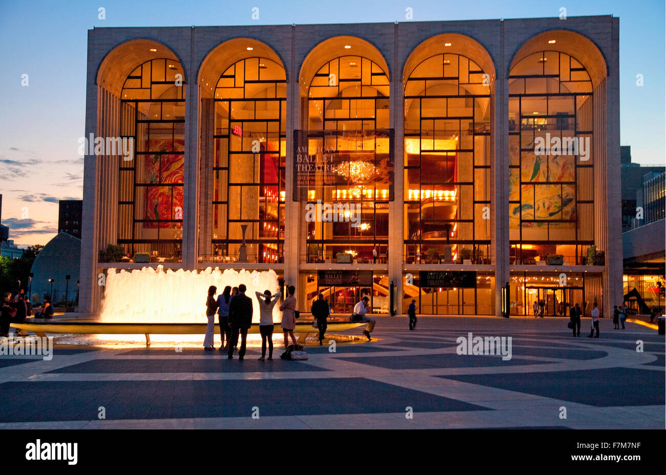 Lincoln Center at dusk, with crowds in front of water fountains, New York, New York - Stock Image