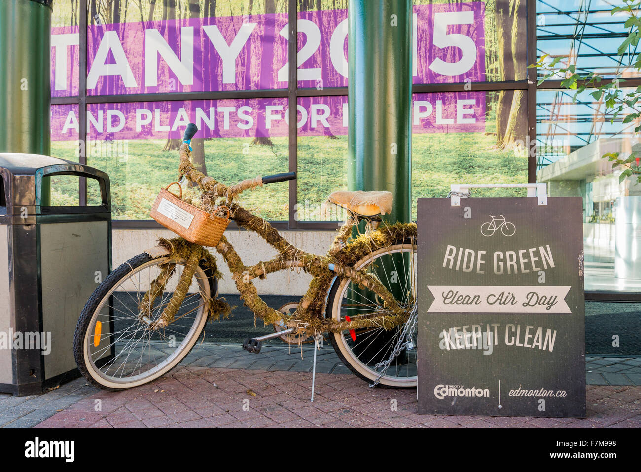 Bicycle wrapped in moss , advertising Clean Air Day, Edmonton, Alberta, Canada - Stock Image