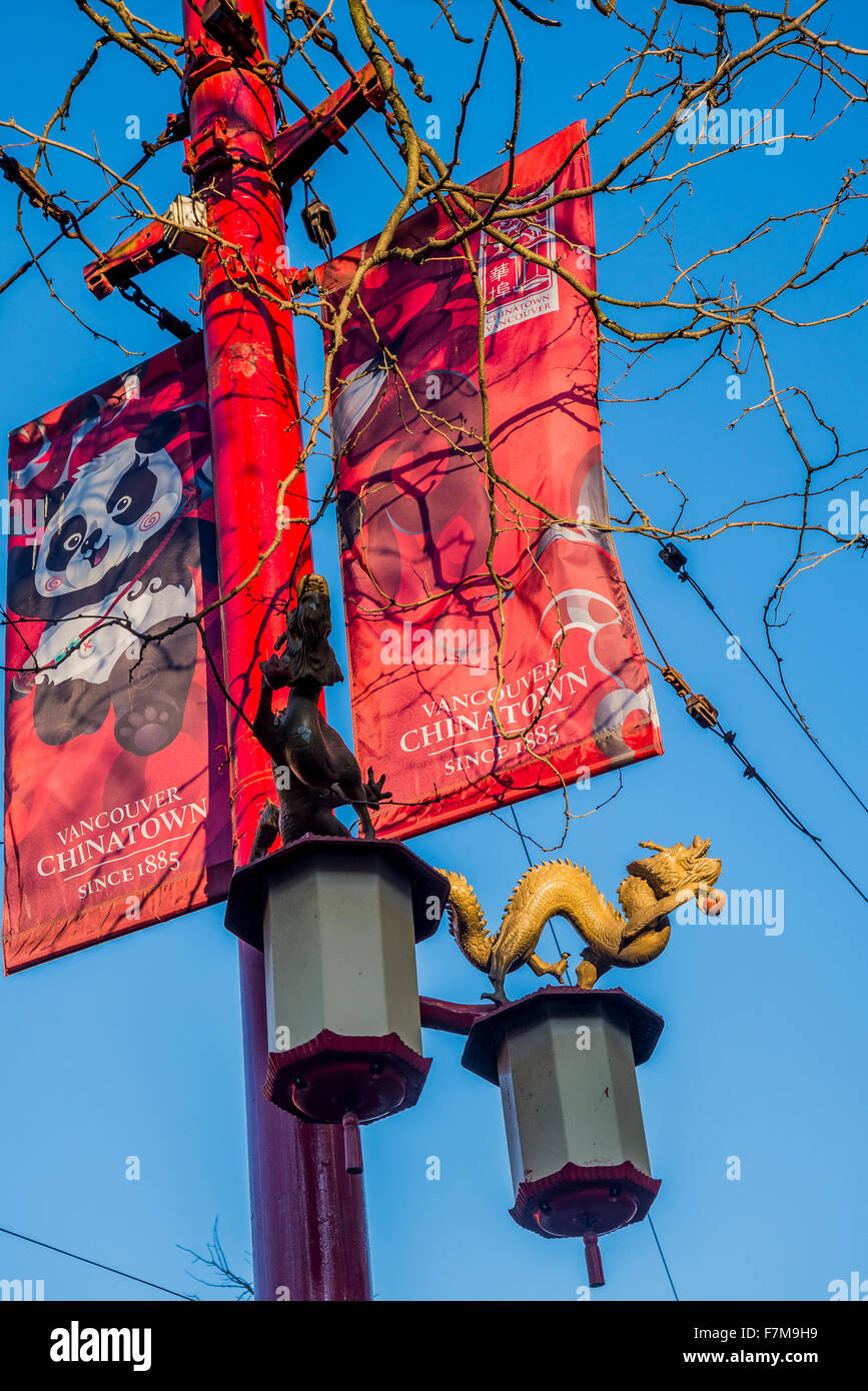 Lamp post with banners and dragon, Chinatown, Vancouver, British Columbia, Canada, - Stock Image