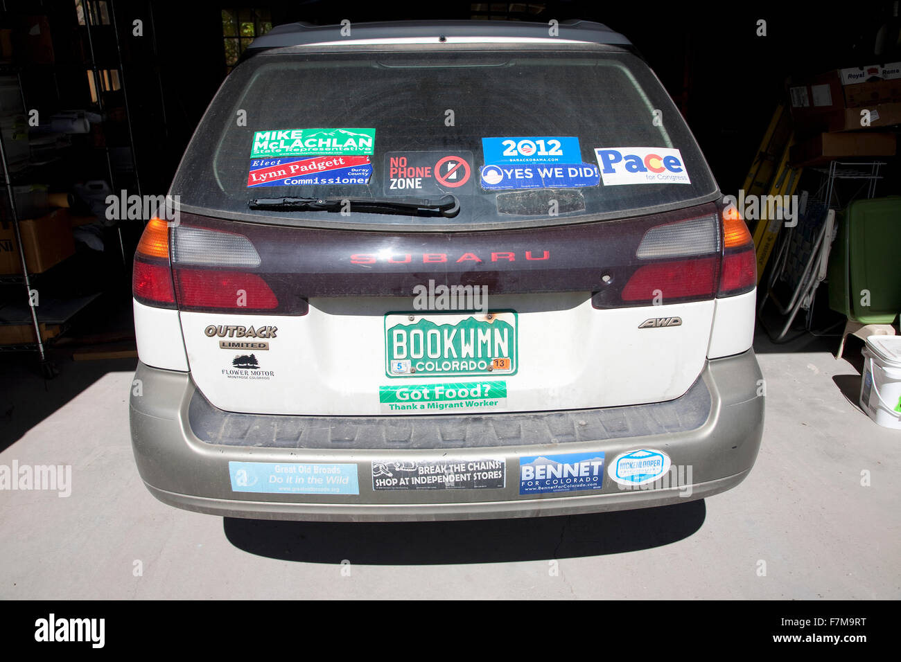 Colorado subaru with many bumper stickers and license plate that reads book woman
