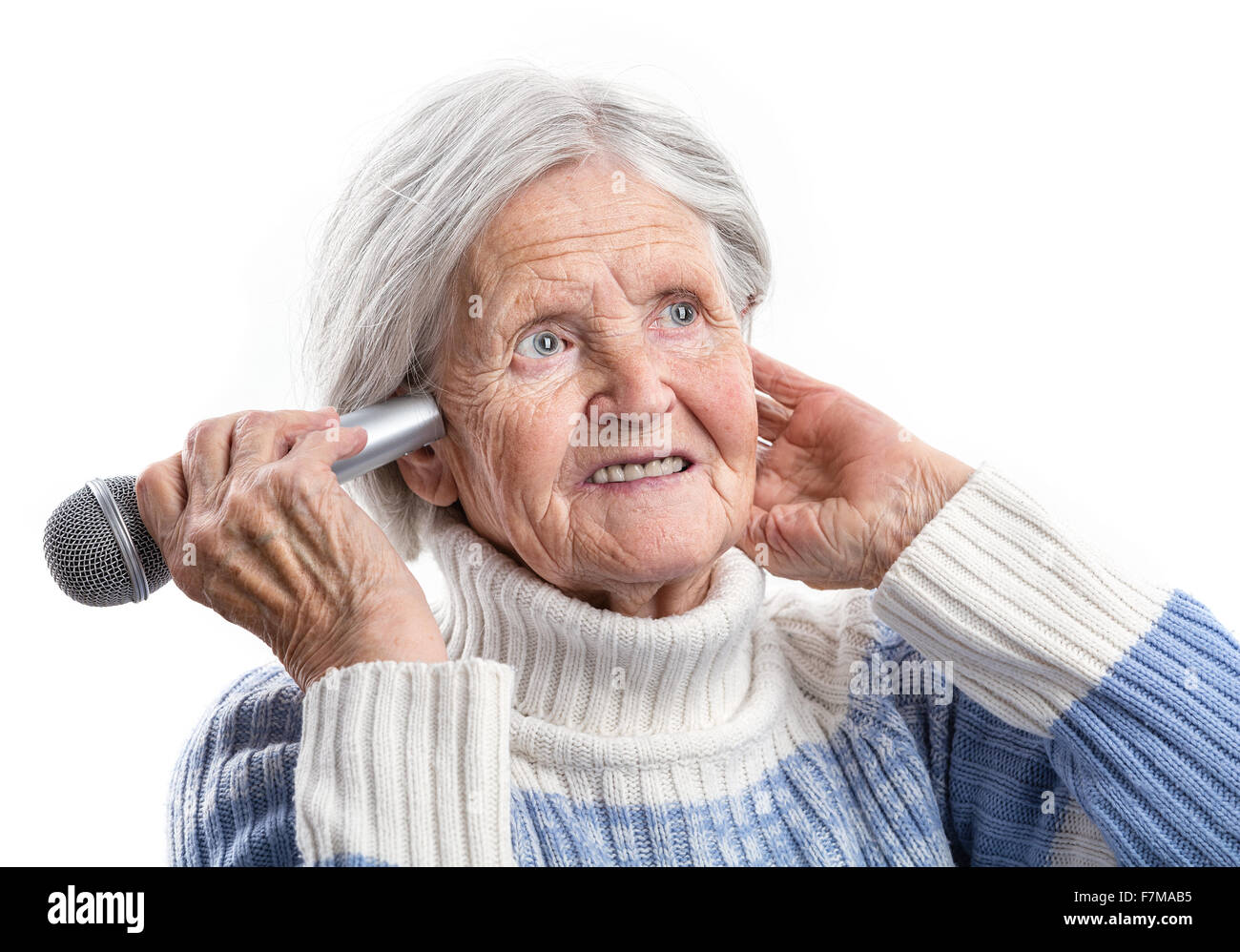 Elderly woman holding microphone close to an ear hearing problems elderly woman holding microphone close to an ear hearing problems publicscrutiny Choice Image