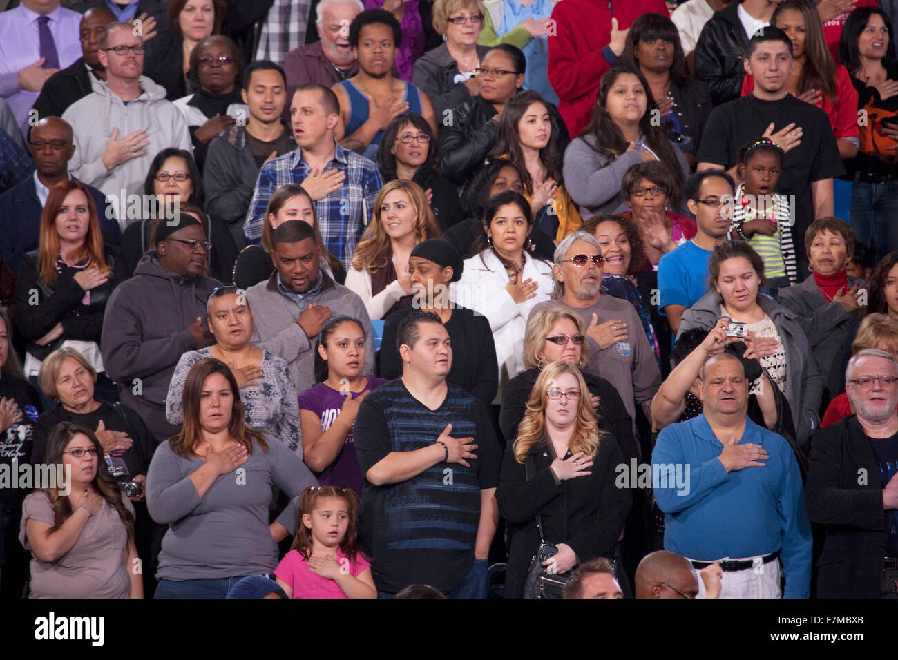 Multi-cultural crowd states Pledge of Allegiance at President Obama Campaign Rally, October 24, 2012, Doolittle - Stock Image
