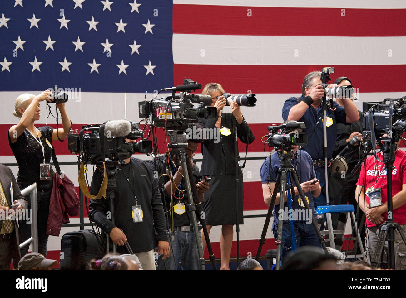 National Press and TV cameramen stand in front of a large US Flag are at an event hosted by First Lady Michelle - Stock Image