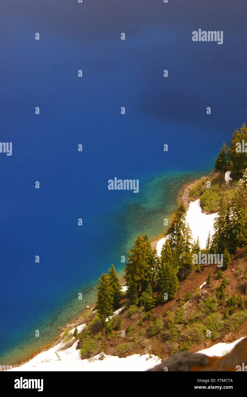 Spectrum of colors in water at Crater Lake, Oregon. - Stock Image