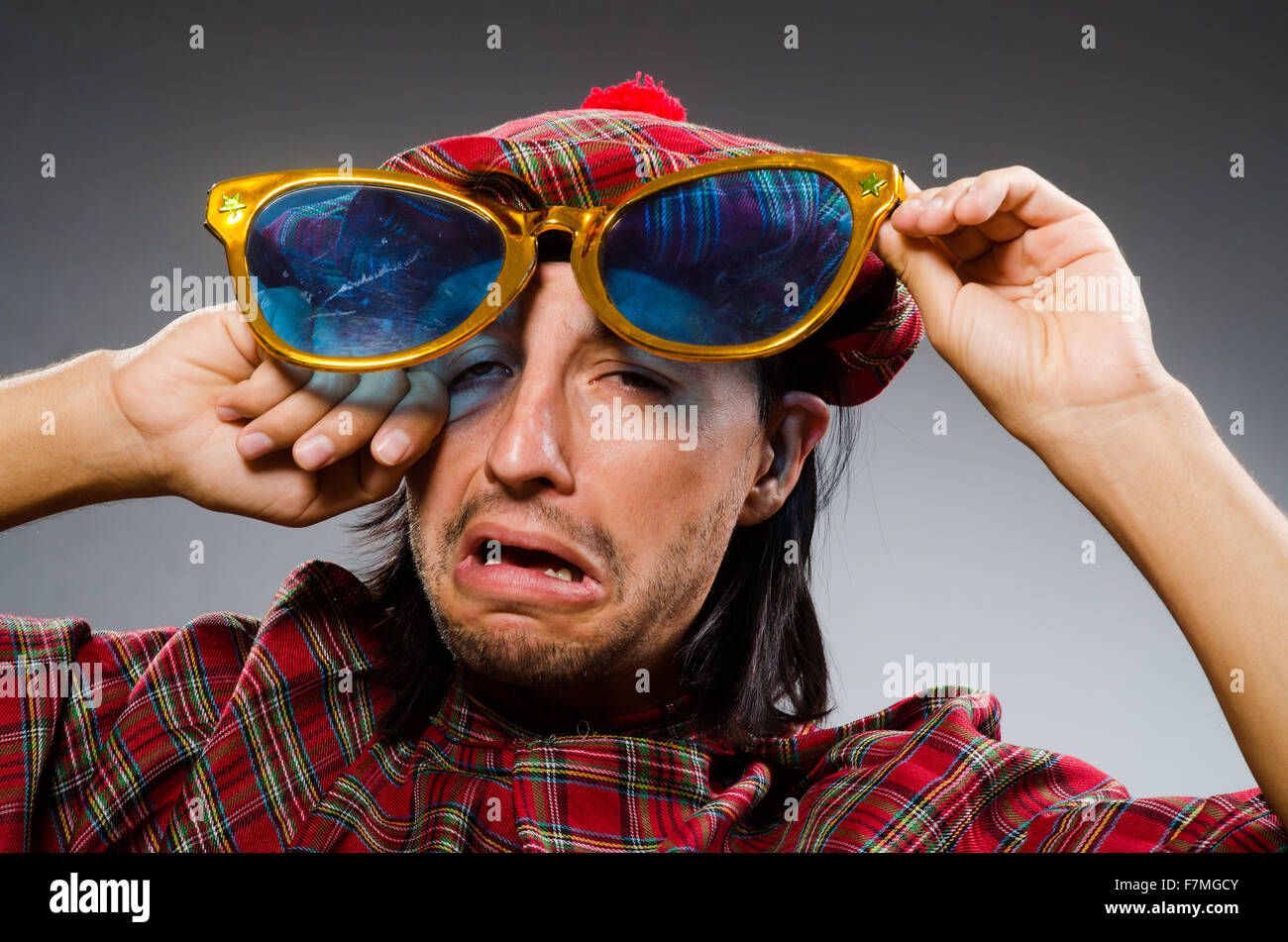 Funny scotsman in traditional clothing - Stock Image
