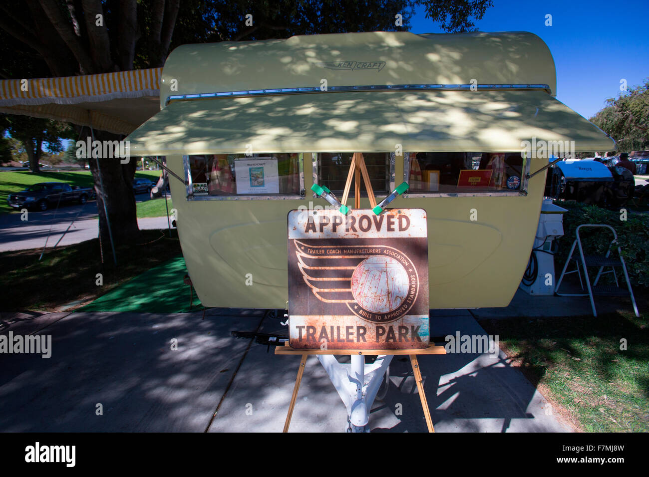 """Sign for """"Approved Trailer Park"""" in front of Yellow Kencraft Trailer at the 4th Annual Vintage Trailer Bash, Flying Stock Photo"""