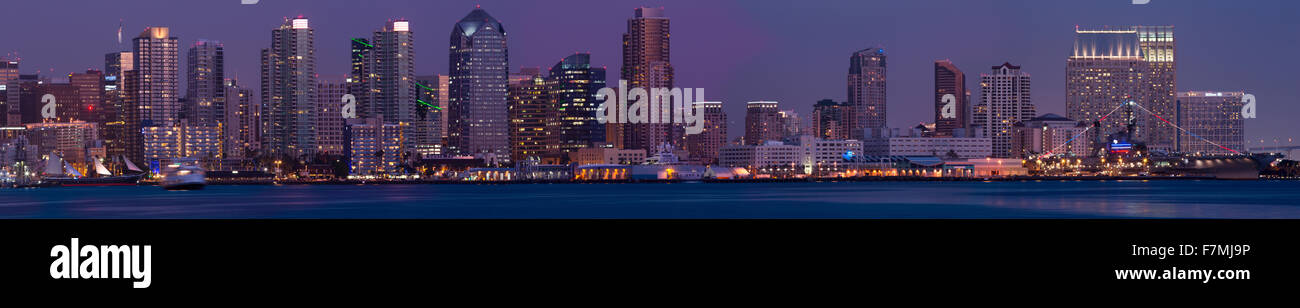 Wide panoramic of scenic San Diego skyline and waterfront at dusk, Pacific Ocean, California - Stock Image