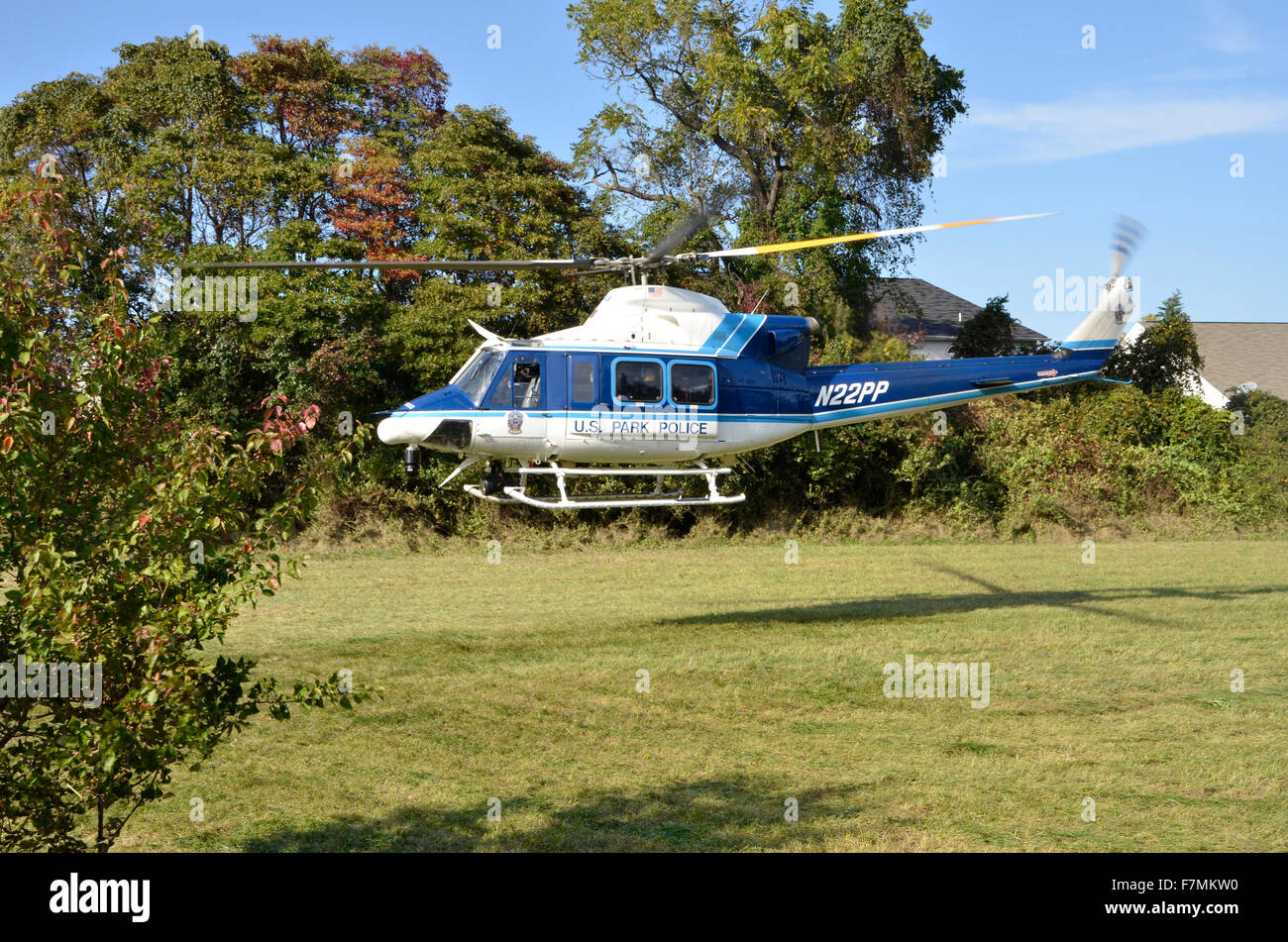 United Staes Park Police medivac helicopter lands in a field in Glendale, Maryland - Stock Image
