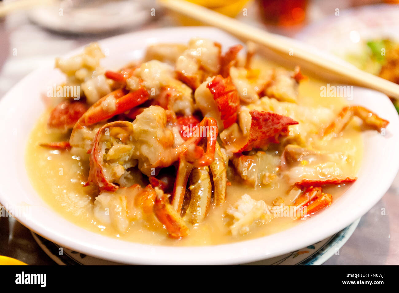 Cut up lobster dish in a white sauce - Stock Image