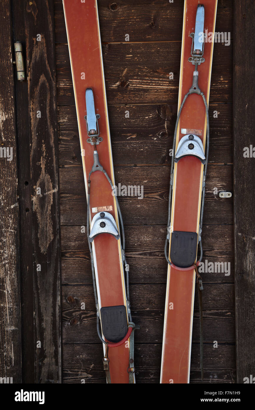 vintage pair of ski against the wooden wall of a skiing hut Stock Photo