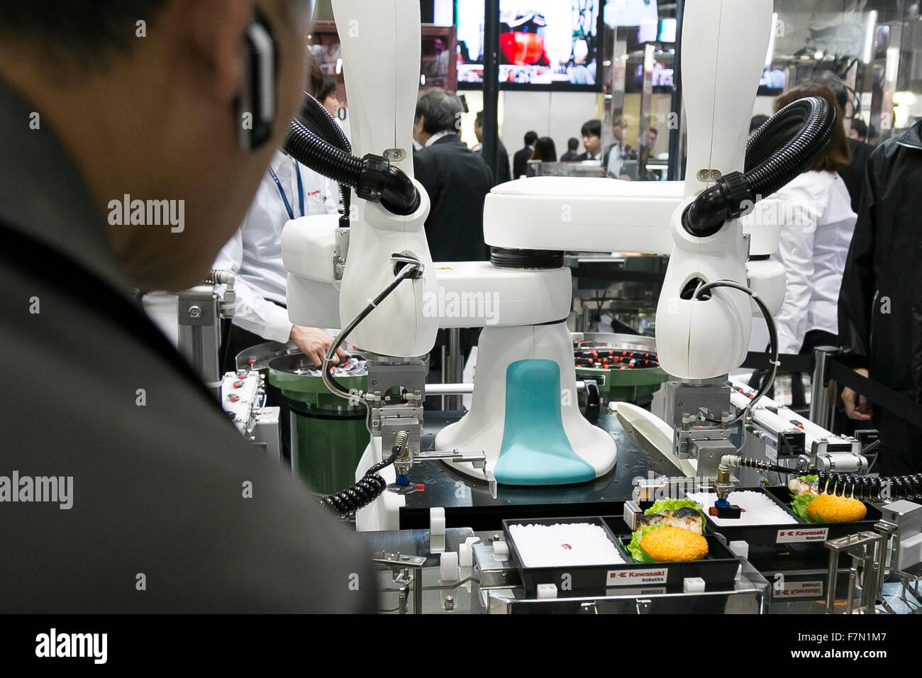 The dual-armed industrial robot duAro of Kawasaki Heavy Industries Ltd. performs at the International Robot Exhibition Stock Photo